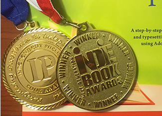 award medals displayed on book