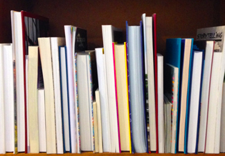 Books on a shelf showing book trim size