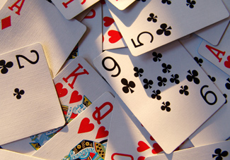 playing cards scattered in layers showing what InDesign layers could do