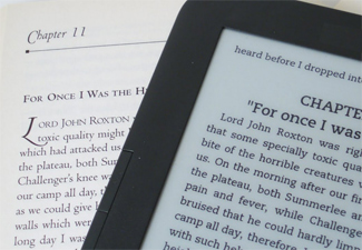 Ebooks vs print books : an ebook sitting on printed version of the same book