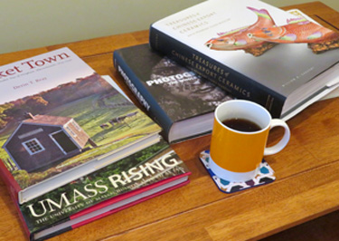 coffee table books on a coffee table