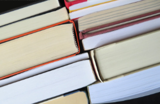 A display of book binding in hardcover and paperback books.